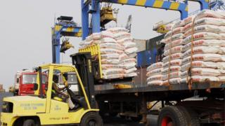 Machines dey off load imported goods for sea port