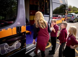 Children boarding the bus