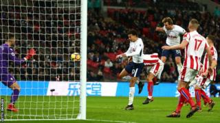 Harry Kane heads in his first goal for Tottenham against Stoke on Saturday