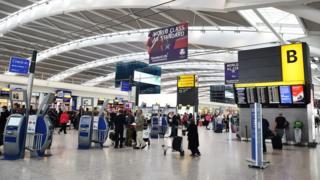 Passengers in Terminal 5 at Heathrow Airport