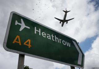 Plane flies over Heathrow sign