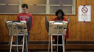 US voters using electronic voting machines
