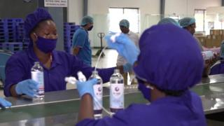 Workers making hand sanitisers at a distillery in Uganda