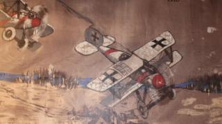 Two planes, one shot down, painted on the canvas