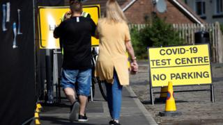 People arrive at a walk-in test facility following the outbreak of the coronavirus disease (COVID-19) in the Farnworth area of Bolton, 15 September