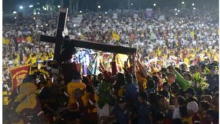 Thousands of Filipino devotees carry the statue of the Black Nazarene during the annual religious procession in Manila. 9 January 2017.