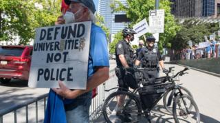 sports Protesters rallied outside the Seattle City Hall before police funding was slashed