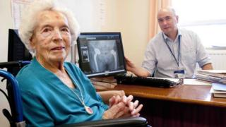 Edith Varley, 104, with surgeon Richard Power