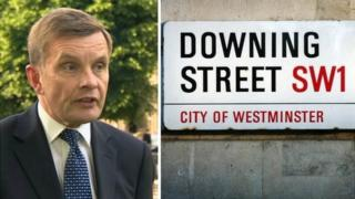 David Jones and Downing Street sign