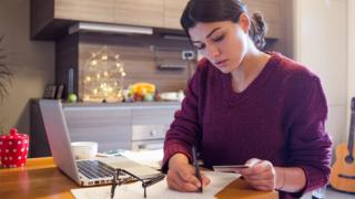 Woman studying finances