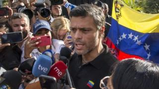 Opposition figure Leopoldo López speaks to reporters at the gate of the Spanish embassy in Caracas, Venezuela. Photo: 2 May 2019
