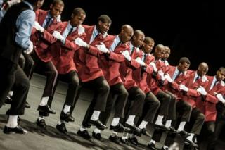 A traditional Isicathamiya group performs at the Natal Playhouse Theatre in Durban on September 23, 2018, during an Isicathamiya competition. - The National Isicathamiya Competition held annually includes over 150 groups competing in the Isicathamiya style, an a capella choral singing style developed in South Africa by migrant Zulu communities.