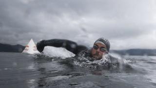 Ross Edgley swimming in the sea off the west coast of Scotland