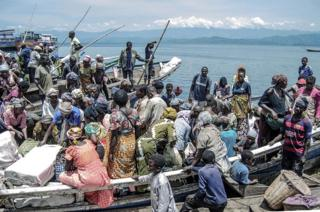 Vendors and shoppers at Kituku market on the shores of Lake Kivu in Goma