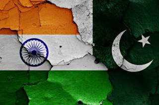 The flags of India and Pakistan painted on cracked wall