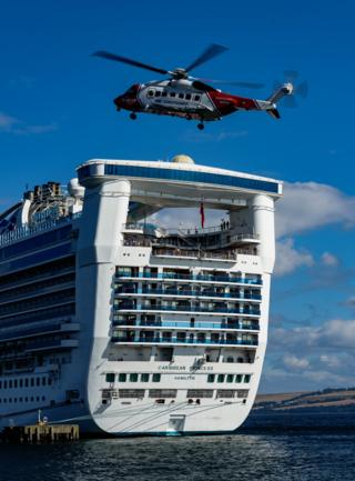 RNLI helicopter and a cruise ship