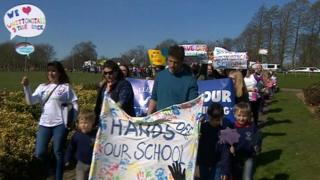 Hundreds of parents protest the council's initial plan