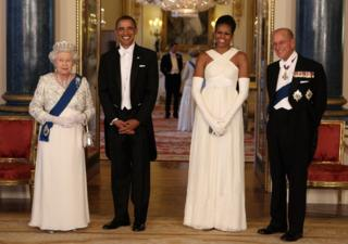 Queen Elizabeth II poses with US President Barack Obama, his wife Michelle Obama and Prince Philip, Duke of Edinburgh in the Music Room of Buckingham Palace ahead of a state banquet on 24 May, 2011 in London, England