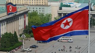 North Korean flags fly from buildings in Kim Sung Square in Pyongyang