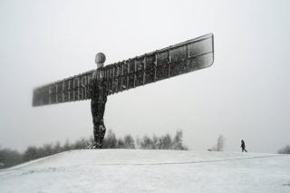 The Angel of the North sculpture covered in snow
