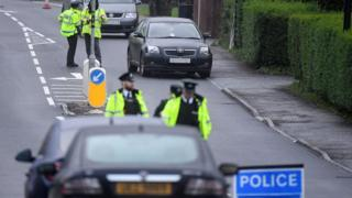 PSNI officers examine the scene where a child was injured