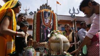 Indian devotees offer prayers at a Shiva temple on occasion of Mahashivratri festival in Ahmadabad, India, Monday, March 7, 2016.