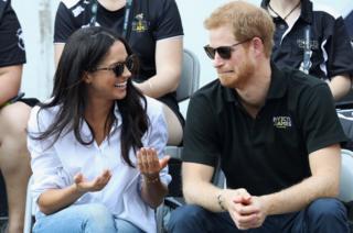 Prince Harry and Meghan Markle share a joke.