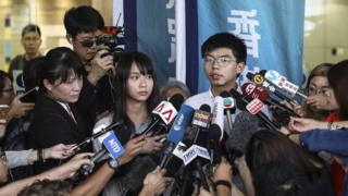 Agnes Chow (L) and Joshua Wong after being released on bail 30 Aug