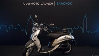 A motorbike is parked on a stage during the launch of UberMOTO at a hotel in Bangkok on February 24, 2016.
