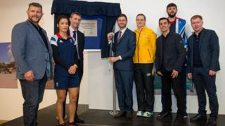 At the plaque unveiling for the opening of Oldham Leisure Centre (from left to right): Barrie McDermott (former Rugby League star), Holly Lam-Moores (GB Handball player), Nigel Harrison (Oldham Community Leisure, chairman), Jim McMahon (Oldham West and Royton MP), Kerry Almond (England netball player), Anthony Crolla (World Champion boxer), Chris McDermott (GB Handball player) and Paul Scholes (former Manchester United and England player).