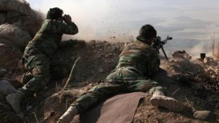 Peshmergas.