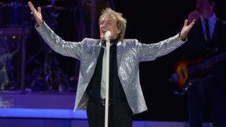 Sir Rod Stewart performing