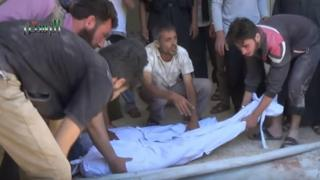 Video posted online by opposition activists purportedly showing men putting bodies onto a stretcher in Rastan, Syria, after government air strike on 18 May 2016