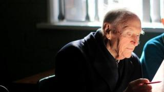 Liam Cosgrave sits in the classroom of his father's old school Mater Dei Primary School in Dublin with current pupil Morgan Campbell