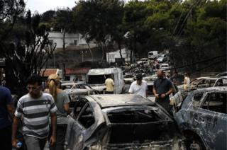 Burnt cars are seen following a wildfire at the village of Mati near Athens, Greece on 24 July 2018.