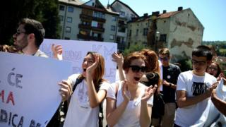 Bosnian high school students hold placards during a protest against segregation at schools in Travnik, Bosnia and Herzegovina, on 20 June 2017