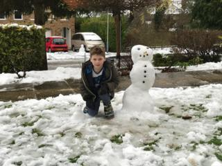 Ethan and his snowman and snowdog