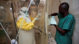 A health worker using Ebola protective equipment enters the Ebola treatment center in the Democratic Republic of Congo