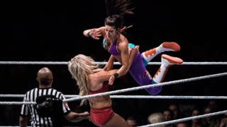 Charlotte Flair and Bayley fight during to the WWE Live Duesseldorf event