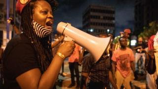 An activist shouts slogans in Accra, Ghana on June 6, 2020 during a protest against the death of George Floyd.