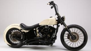 Harley Davidson signed by Pope fetches £42,000 in Stafford