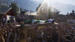 Kashmiri Muslims shout freedom slogans as they carry the body of Nasir Shafi during his funeral procession on the outskirts of Srinagar, Indian controlled Kashmir, 17 September