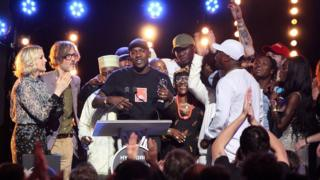Skepta on stage with his friends and family at the Mercury Prize