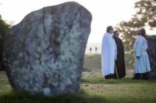 People at the Avebury stone circle in Wiltshire