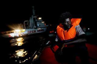 Ahmed, 38, from Sudan, sits on board the NGO Proactiva Open Arms rescue boat in the central Mediterranean Sea