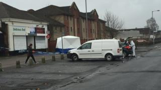 Forensics officers were working around Delicious Deli in Fleming Avenue