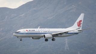 A Boeing 737-89L passenger plane belonging to the Air China lands at Hong Kong International Airport on August 01 2018 in Hong Kong, Hong Kong.