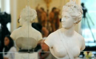 The marble bust of the antique goddess Diana is presented during a ceremony of return at the Lazienki Palace in Warsaw, Poland, Friday, Dec. 18, 2015.