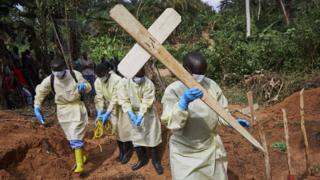 Health workers bury an 11-month-old child in North Kivu, Democratic Republic of the Congo, May 05, 2019.
