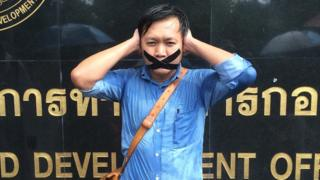 Thai journalist Pravit Rojanaphruk protesting after the coup in May 2014